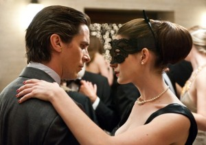 Christian Bale as Bruce Wayne and Anne Hathaway as Selina Kyle